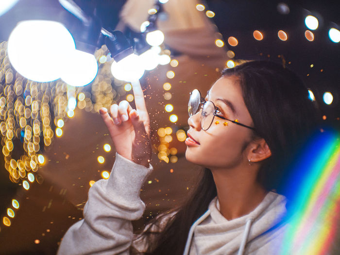 touch of your love Illuminated Real People Lighting Equipment Lifestyles Leisure Activity Headshot Portrait Women Girls Light - Natural Phenomenon Glowing Child Focus On Foreground Holding Night Glasses People Young Adult Childhood Outdoors Light Fairytale  Fairy Lights EyeEm Best Shots Star