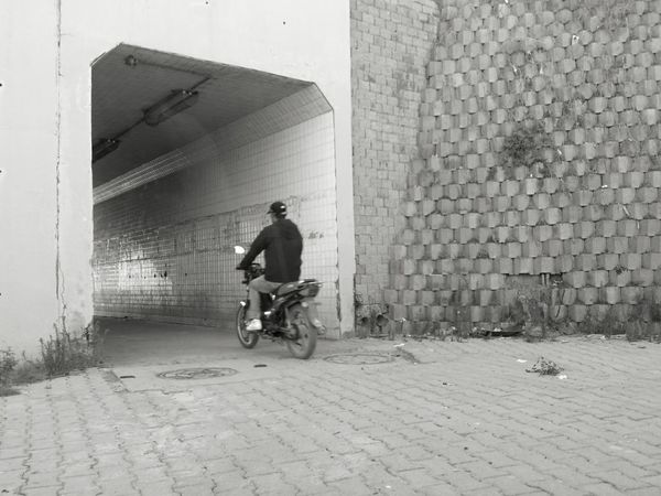 Motorcycle Land Vehicle Transportation Mode Of Transport Biker One Person Built Structure Day Outdoors One Man Only Only Men Architecture Tunnel Tunnel Entrance Building Exterior City Adult Adults Only