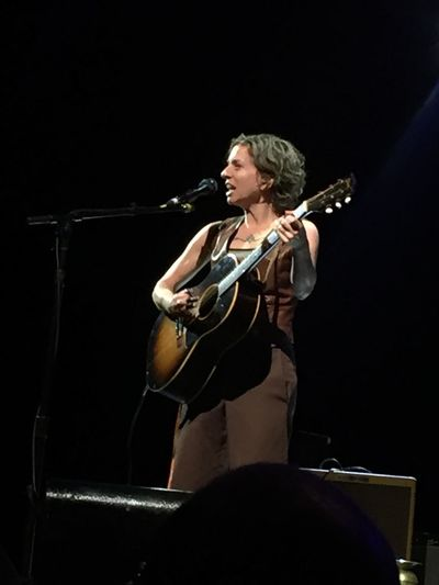 Ani DiFranco (null)Music Musical Instrument Performance Musician Arts Culture And Entertainment Playing Stage - Performance Space Performing Arts Event Skill  Event Real People Microphone One Person Indoors  Illuminated Singing Electric Guitar Black Background Womeninmusic Guitar Guitarist