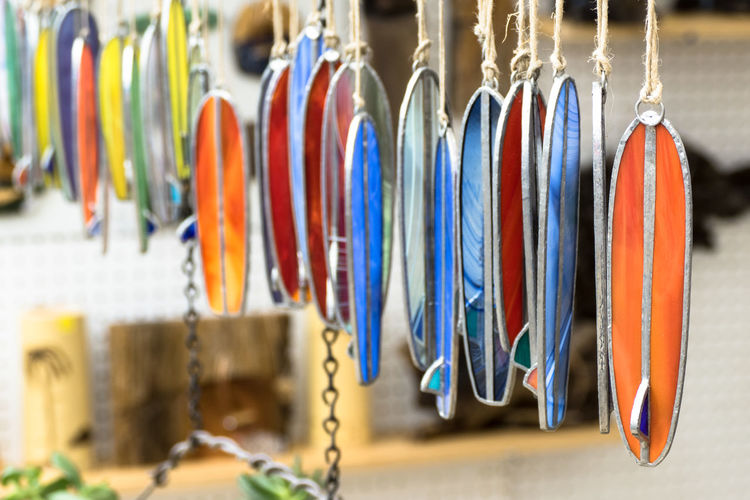 Long Board surfing contest Choice Close-up Day Focus On Foreground For Sale Hanging In A Row Indoors  Large Group Of Objects Market Multi Colored No People Retail  Stained Glass Stained Glass Surfboards Surfboards Variation