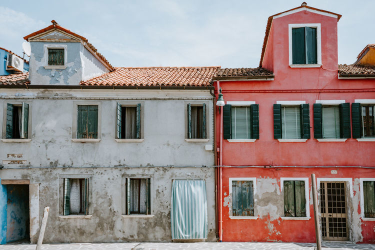 Colourful houses in Burano, Italy Architecture Building Building Exterior Built Structure Day Façade House Low Angle View No People Old Outdoors Residential District Roof Roof Tile Sky Window