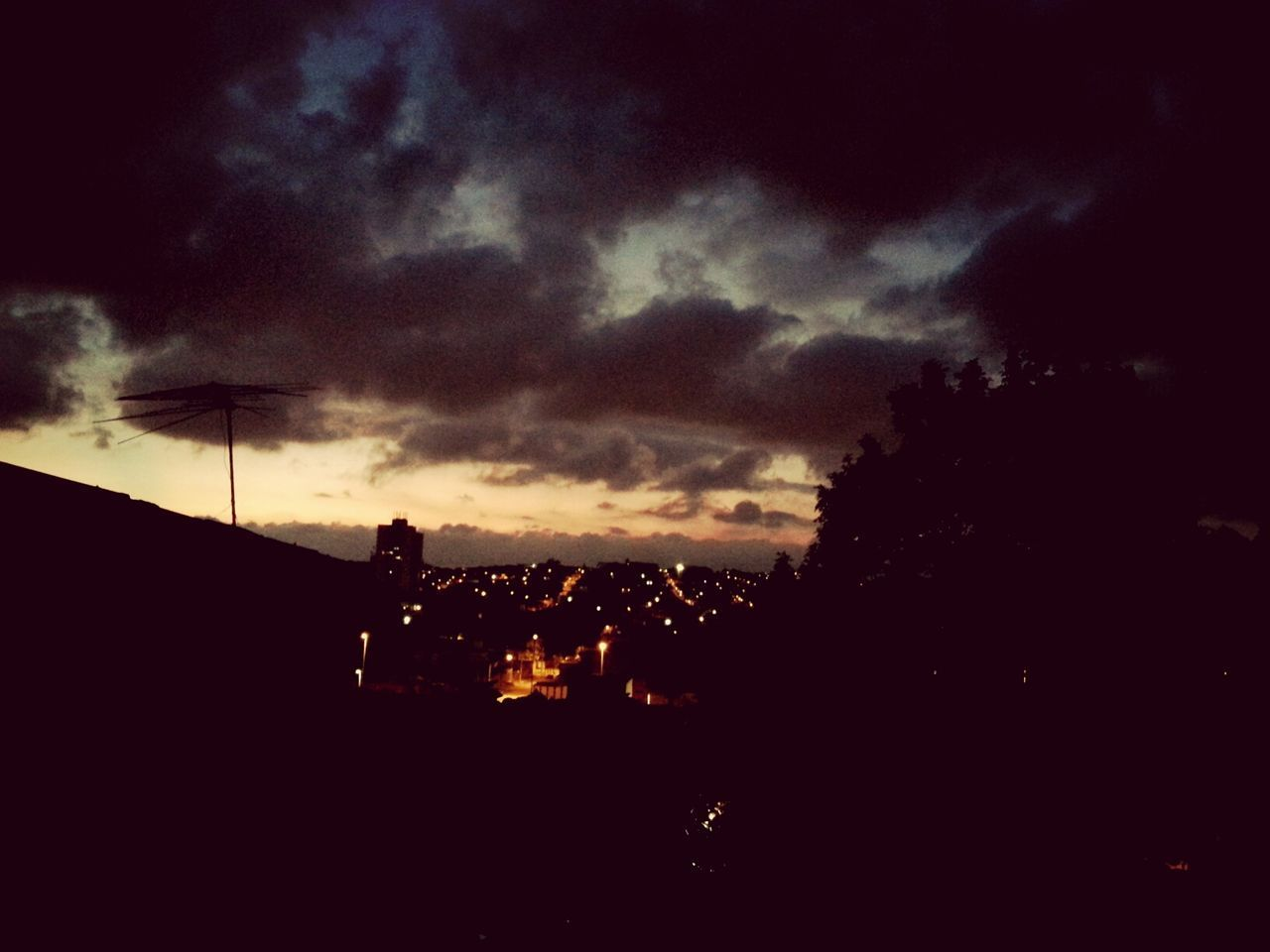 building exterior, sky, architecture, built structure, cloud - sky, silhouette, illuminated, city, cloudy, night, storm cloud, dusk, weather, residential structure, dramatic sky, dark, residential building, sunset, overcast, cloud