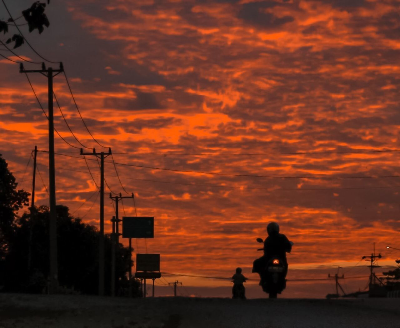 SILHOUETTE COUPLE ON ORANGE SKY DURING SUNSET