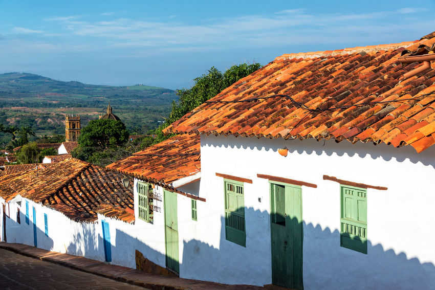 Old colonial town of Barichara, Colombia with the cathedral in the background Architecture Barichara Building Colombia Colonial Exterior Façade Front Historic History Landmark Latin Old Rustic Santander Southamerica Spanish Street Tourism Town Travel Typical Village Wall White