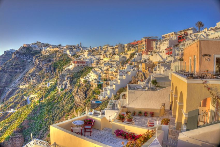 Sunset reflections above the city of Fira Architecture Built Structure Clear Sky Building Exterior Outdoors Day High Angle View Sunlight Residential Building Blue No People Mountain Nature Tree Sky Cityscape Viewpoint Landscape Travel Destinations Architecture Sunset Tourism