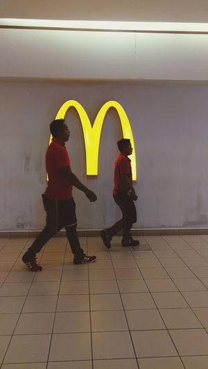 Two People Adults Only Togetherness Yellow Men Young Adult Working McDonald's Street Life Mall Two Man Red Color Togetherness Friendship Same Color