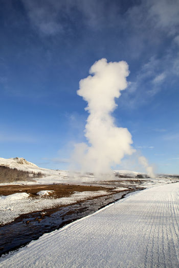 Beauty In Nature Blue Cold Temperature Erupting Geyser Hot Spring Iceland Iceland Memories Iceland Trip Iceland_collection Landscape Mountain Nature Non-urban Scene Outdoors Physical Geography Scenics Sky Snow Steam Strokkur Strokkur Geysir Tranquil Scene Tranquility Winter