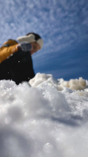 Low angle view of man against sky during winter