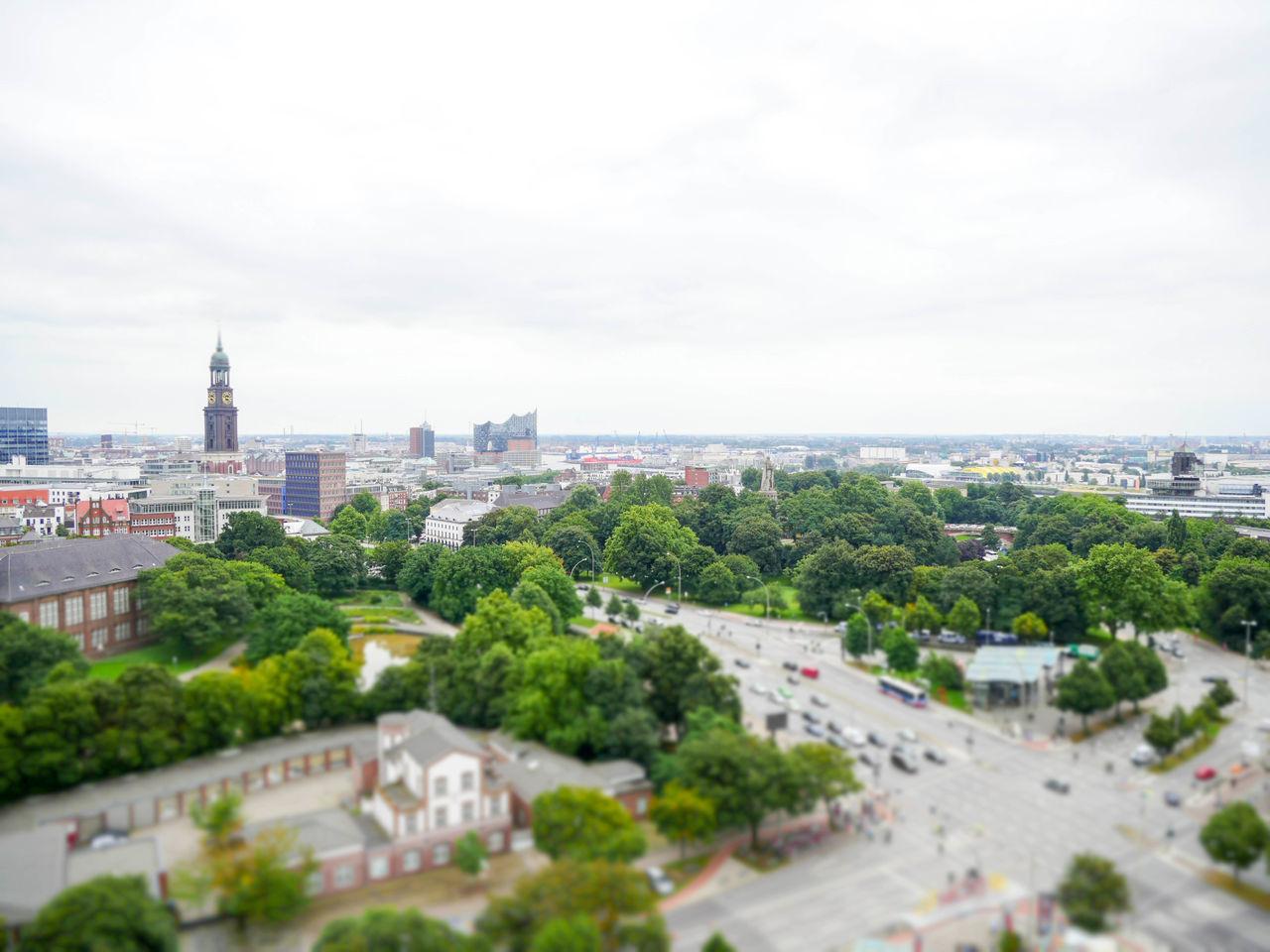 Tilt Shift Image Of City Against Sky