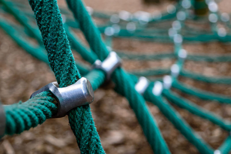 Cropped image of green rope equipment in playground