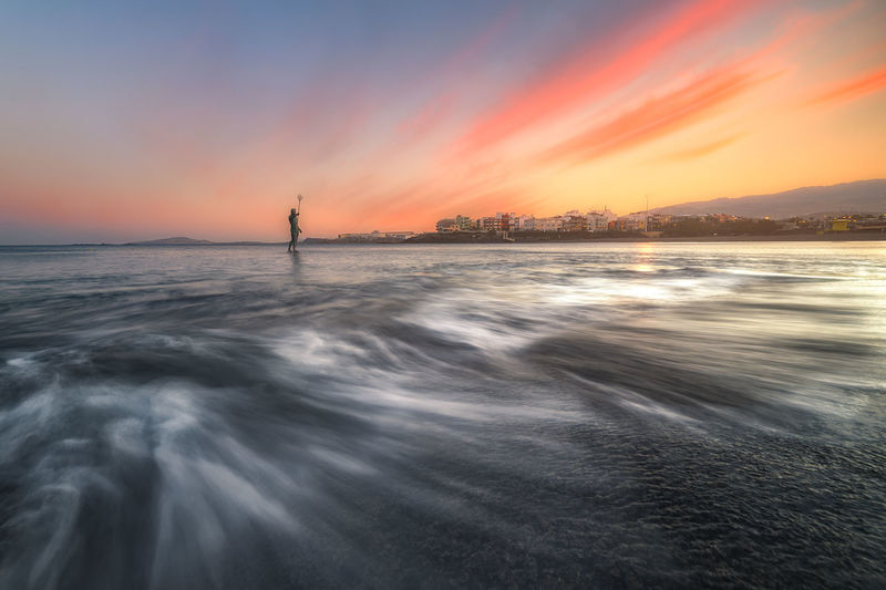 Neptune Water Neptune Movement Sunset Cloud - Sky Longexposure Landscape Seascaoe Sea Sky Beauty In Nature Scenics - Nature Orange Color One Person Waterfront Motion Horizon Over Water Horizon Real People Lifestyles Idyllic Blurred Motion Nature Standing Men Outdoors