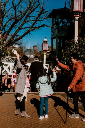 really cute Asian family at Tivoli Gardens Family Family With One Child Amusement Park Fairground High Five Rear View Portrait Photography Street Photography Real People Full Length Togetherness Friendship Women Men Arts Culture And Entertainment Enjoyment Dancing City Life