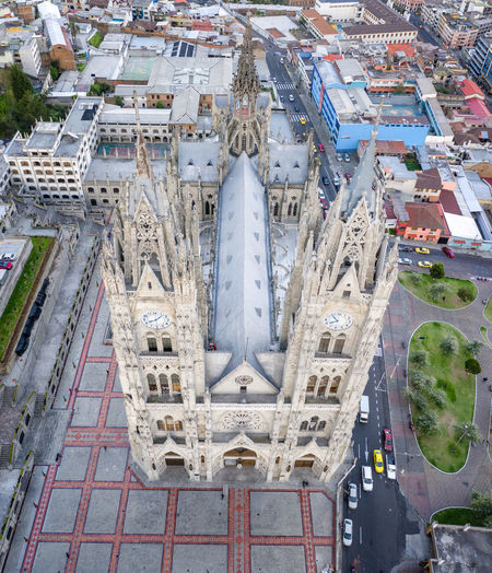 Aerial view of the Basilica del Voto Nacional in Quito, Ecuador. This is the tallest cathedral in south America of neolithic style architecture. Architecture City Building Exterior Built Structure High Angle View Transportation Day Building Mode Of Transportation Travel Travel Destinations No People Road Aerial View Water Tourism Residential District Outdoors Cityscape