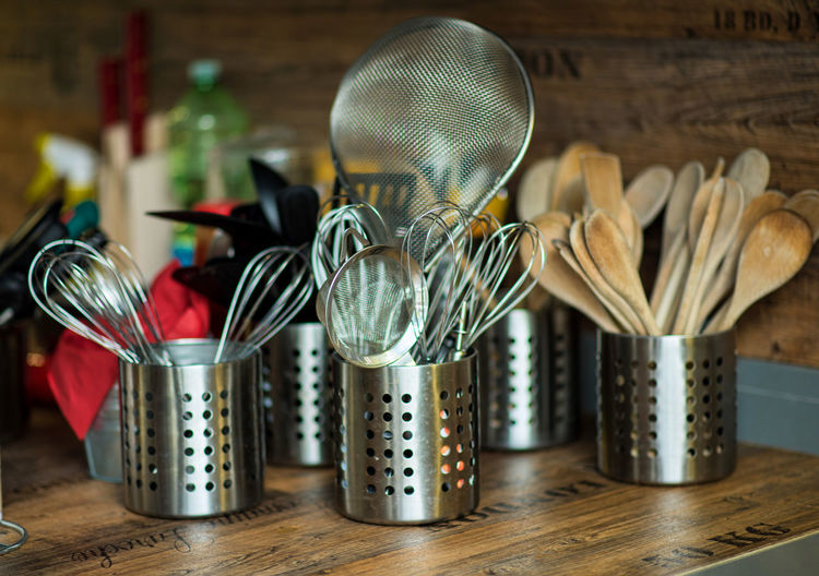 Close-up of kitchen utensils on table