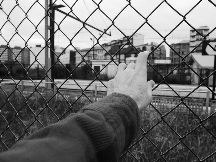 City Avilés Barrier Black And White Blackandwhite Chainlink Fence Day Fence Focus On Foreground Hand Human Hand Nature One Person Outdoors Personal Perspective