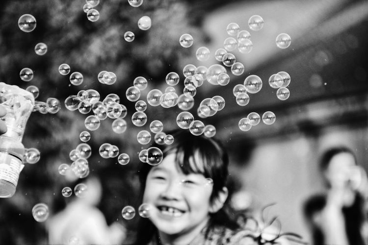 An amazing moment while I walk around the HUA SHAN playground...Children's smile always WON~! Amazing View Black And White Photography Black And White Portrait Bubble Childhood Close-up EyeEm Taiwan Monochrome Photography Happy People Lifestyles Moment Outdoors Showcase May Smile Smiling Street Streetphotography The Great Outdoors - 2016 EyeEm Awards The Portraitist - 2016 EyeEm Awards The Street Photographer The Street Photographer - 2016 EyeEm Awards The Week Of Eyeem The Week On Eyem Vscocam Nature Light Portrait