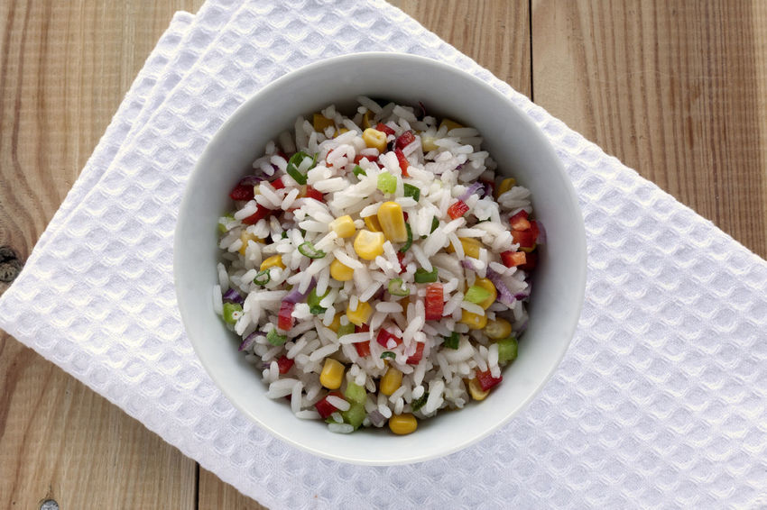 Rice and vegetables salad .Red and green bell peppers, corn grains, onion and scallion. On a wooden background. Diet Natural Light Vegetarian Food Bowl Close-up Colourful Salad Directly Above Food Food And Drink Fresh Salad  Freshness Healthy Eating Healthy Lifestyle No People Ready-to-eat Studio Photography Summer Salad Vegan Food White Napkin