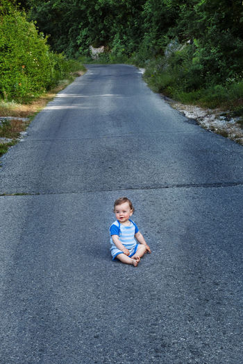 High angle view of boy on road
