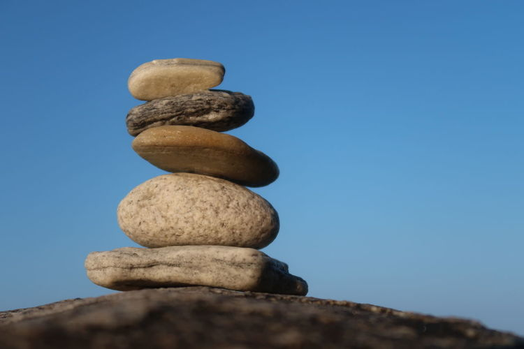 Stone balancing Nature Sky Yoga Stones Blue Meditation Stone Outdoors Rock Tranquility Zen Stacked Clear Sky Rock Formation Balance Buddhism Close-up Stack Solid Pebble No People Stacked Stones Rock - Object Stone - Object Zen-like Stack Rock Religion Relaxing