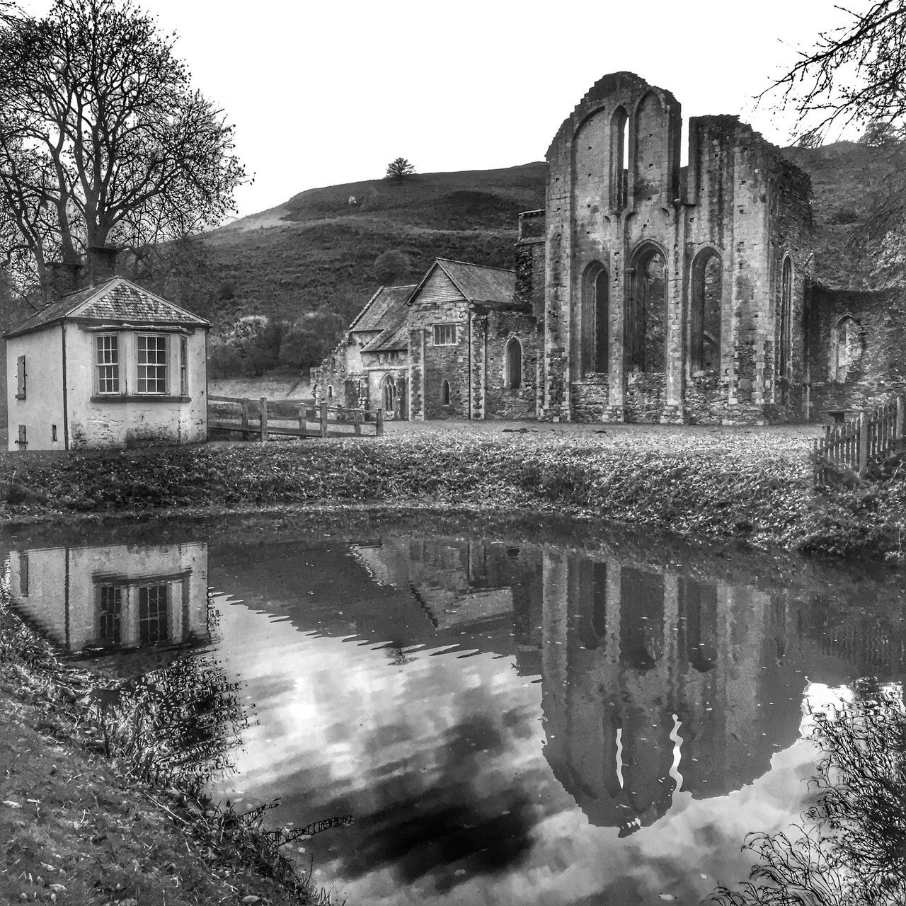 architecture, built structure, building exterior, water, reflection, house, no people, outdoors, day, tree, old ruin, clear sky, sky, nature