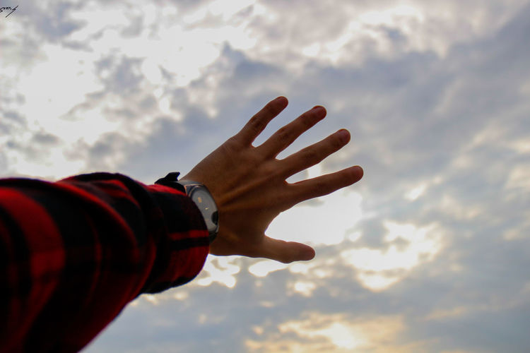 Beauty In Nature Close-up Cloud - Sky Day Human Body Part Human Hand Low Angle View Nature One Person Outdoors Real People Sky AI Now Love Yourself