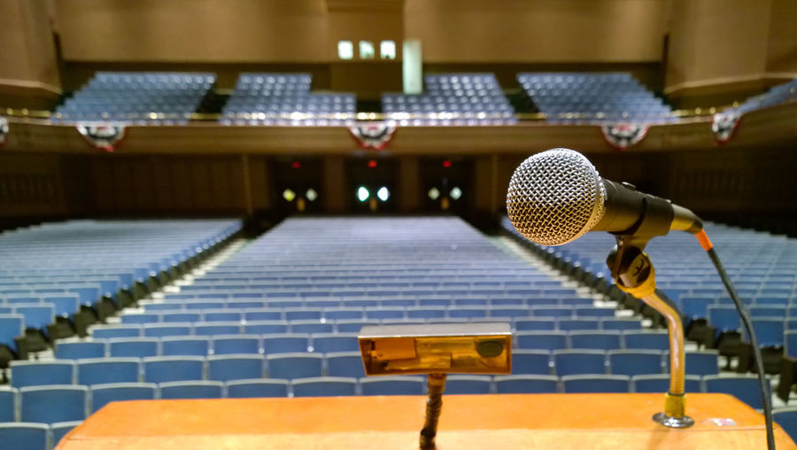 Close-Up Of Microphone In Conference Hall