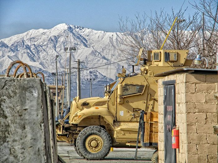 Armored Vehicle Against Snowcapped Mountain