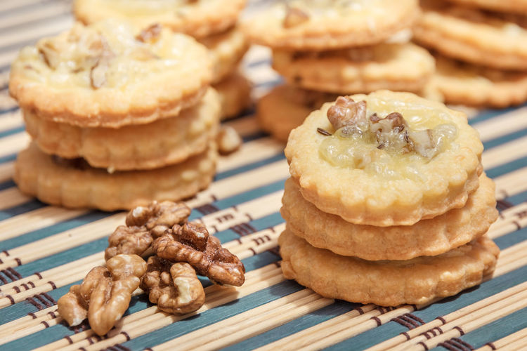 spicy cookies and walnuts on the bamboo napkin Baked Bamboo Cheese Chopped Cookies Cumin Food Food And Drink Grated Homemade Melted Napkin No People Pastries Snack Spices Stack Walnuts