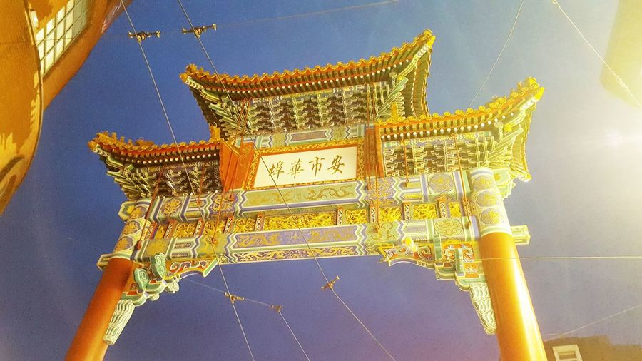 Gate to chinatown in antwerp, belgium Night Illuminated Gate Chinatown Entrance Chinese Traditional Gateway Arch City King - Royal Person Yellow History Backgrounds Sky Close-up