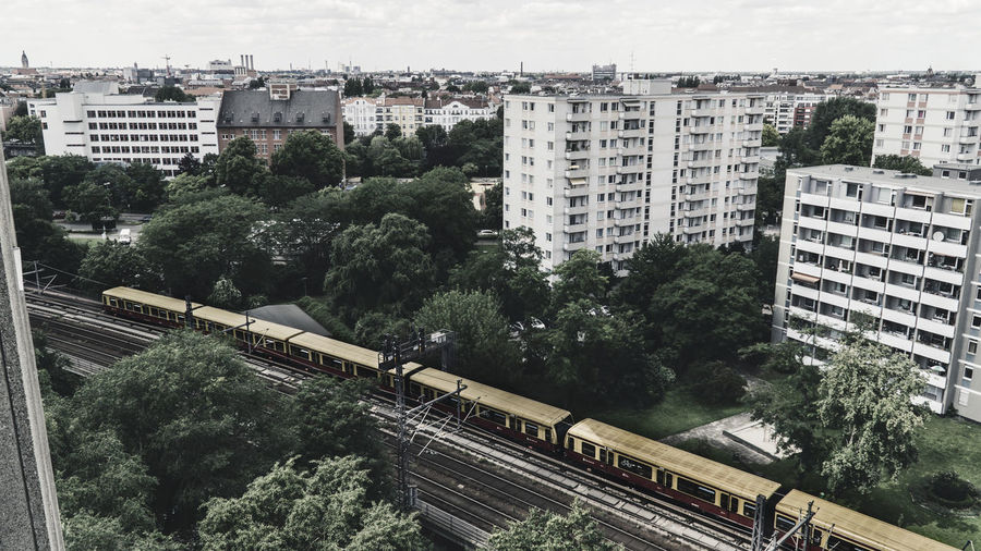 High angle view of train by railroad tracks in city