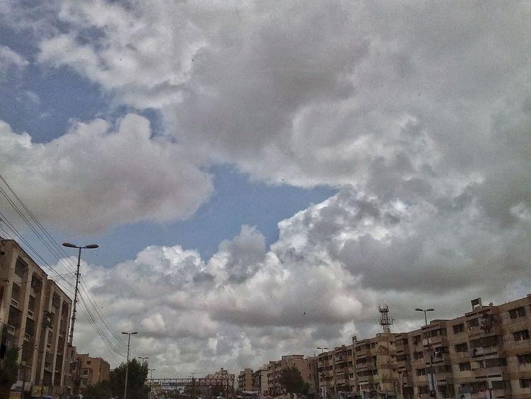 Cloud - Sky Architecture Built Structure Low Angle View Building Exterior City Nature Personal Perspective Lookuptothesky Lookupandthrive Cloudsporn Cloudscape Heavyclouds Karachi EyeEm Karachi Pakistan