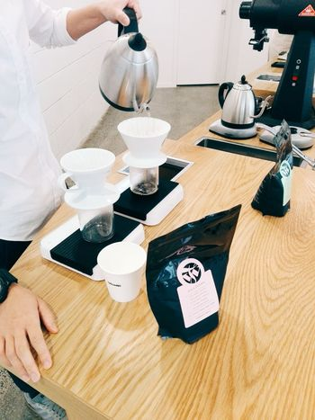 Pourover at Catalyst Coffee. Barista Cafe Coffee Coffee - Drink Coffee Break Coffee Cup Coffee Shop Coffee Time Cup Drink Filter Coffee Food And Drink Freshness High Angle View Holding Human Hand Indoors  Lifestyles Making Coffee One Person Pourover Real People Refreshment Table Vscocam