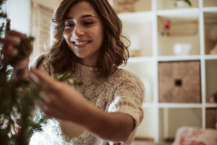 Young woman smiling at home