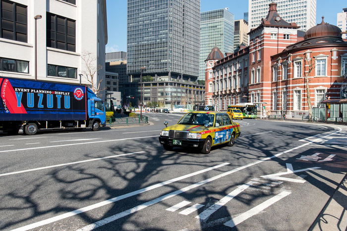 Missing the Natural Shade of the Trees Architecture Building Exterior City City Street Cityscape Day No People No Traffic Outdoors Shadows & Lights Skyscraper Street The City Light Tokyo Train Station Travel Destinations Trees Urban Road Yellow Taxi