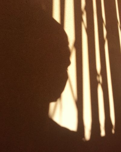 High angle view of silhouette shadow on wall