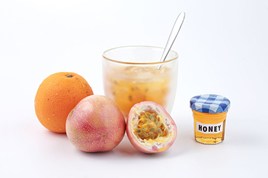 Passion fruit, orange and freshly squeezed juice with honey Ais Beverage Cocktail Cold Drink Food Freshness Freshness Fruit Glass Healthy Healthy Eating Honey Juice Orange Color Passion Fruit Soda Sour Summer Sweet Sweet Food Tropical Fruits Water White Background Yellow