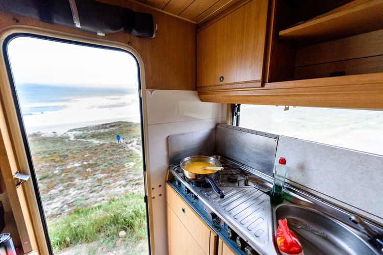 Cooking dinner or breakfast in camper RV with beach view. Preparing eggs with magnificant view of Nemiña beach Galicia Spain. Traveling with RV, motor home caravan or motorvan. Transportation Mode Of Transportation Environment Vehicle Interior Food No People Nature Day Window View Motorhome Motor Home Campervan Camper Van Adventure Breakfast Eggs Pan Kitchen SPAIN Atlantic Ocean Nemiña Beach Nemina Galicia Galicia, Spain Motorvan Rv Recreational Vehicle Cooking Travel Traveling Jurney Trip