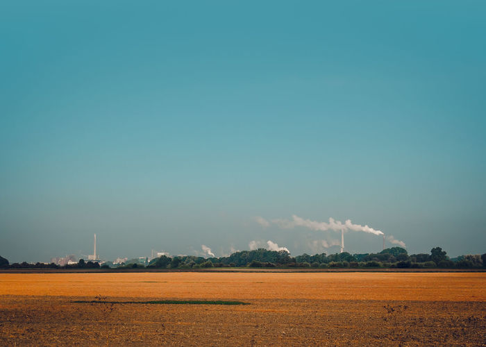Nature landscape and smoke from the chimney Autumn Chimney Power Plant Production Smoke Sunlight Agriculture Blue Sky Chemistry Day Environment Factory Field Germany Heating Landscape Manufacturing Outdoors Pharmaceutical Industry Pipe Polluted Pollution Rural Scene Scenics Technology