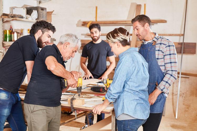 People working on table in workshop