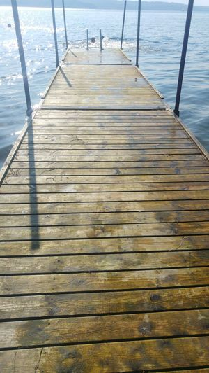 Water Pier Sea Wood - Material The Way Forward Calm Tranquility Tranquil Scene Lake Scenics Jetty Wood Paneling Railing Relaxation Day Nature Wooden Surface Level Solitude Outdoors