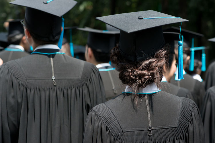 Rear View Of People At Graduation Ceremony