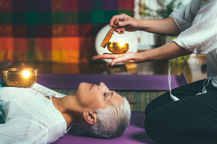 Sound Therapy Meditation Tibetan Singing Bowl Sound Singing Bowl Therapy Tibetan Bowl Bowl Sound Healing Senior Woman Mid Adult Woman Women Only Sound Yoga Vibration Buddhism Buddhist Stick Meditating Healing Music Therapy Spiritual Harmony Instrument Balance Spirit Relaxation Traditional Alternative Medicine Guided Mantra Indian Drum Tibetan  Tone Ascetic Training Zen Energy Nada Yoga Frequency Resonate Essence Bioenergy Music Acoustic Awareness Pain Management Stress Management Sound Bath Mindfulness Holistic Revitalize