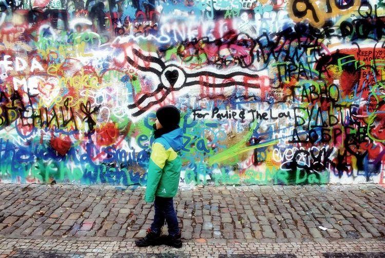 Full length of woman standing in graffiti