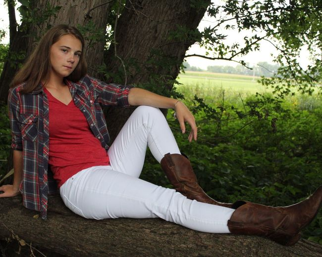 Senior Pictures Sitting Full Length One Person Tree One Young Woman Only Casual Clothing Tree Trunk