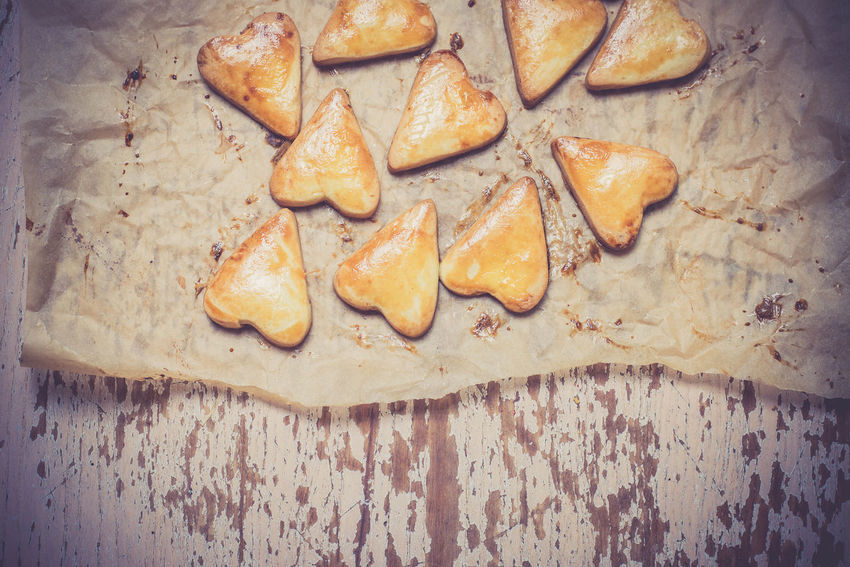Heart shape cookies on the baking paper Baking Paper Bread Close-up Cookies Crusty Day Dessert Food Food And Drink Freshness Gold Healthy Eating Heart Shape Heart Shape Cookies Indoors  Kitchen No People Ready-to-eat Yummy