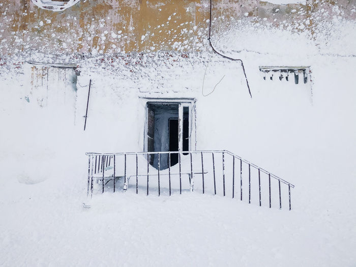 Entrance of snow covered house