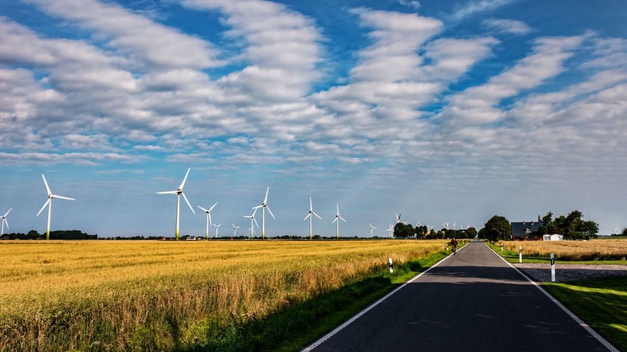 street Alternative Energy Beauty In Nature Blue Cloud - Sky Day Environmental Conservation Field Fuel And Power Generation Grass Industrial Windmill Landscape Nature No People North Germany Outdoors Renewable Energy Road Rural Scene Scenics Sky The Way Forward Tranquility Wind Power Wind Turbine Windmill