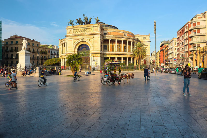 Politeama square Palermo People Watching Place Politeama Sicily Square Theater Architecture Building Exterior Built Structure City Day History Italy Landscape Large Group Of People Men Outdoors People Politeama Theater Real People Sculpture Sky Statue Women
