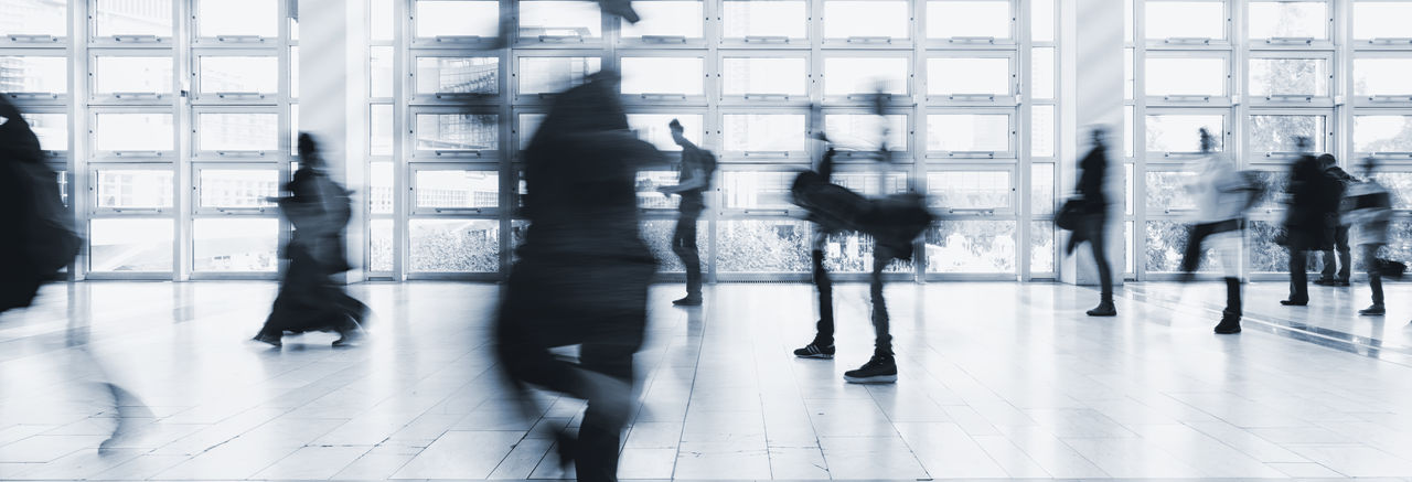 Blurred Motion On People Walking In Corridor