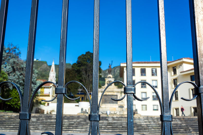 Monument to the battle of Ayacucho with bars in front of it in Bogota, Colombia Architecture Ayacucho  Battle Battle Of Ayacucho Blue Blue Sky Bogotá Candelaria Church Colombia Colonial Culture El Carmen La Candelaria Memorial Monument Sculpture Sky South America Travel